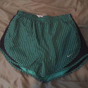 Nike Dri-Fit running shorts.